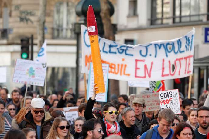 "French school teachers, from the ""Stylos Rouges"" (Red Pens) mouvement, demonstrate against French Education minister Blanquer's law as part of a protest against the French government's reforms in Paris,"